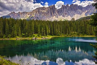 Latemar mountain range reflected in Lake Carezza (Karersee) in summer, South Tyrol, Dolomites, Italy, Europe
