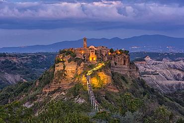 Civita di Bagnoregio and surrounding badlands just after sunset, Lazio, Italy, Europe