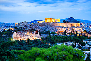 The Acropolis and the Parthenon at night in Athens, Attica, Greece