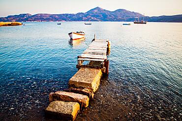 Pier and fishing boat, Milos, Cyclades, Greek Islands, Greece, Europe