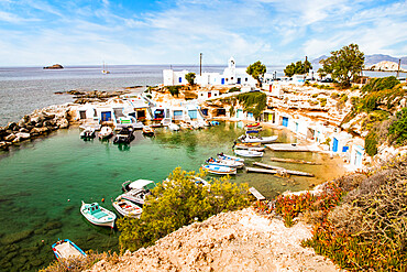 View over fishing harbour with boats and colourful boat houses, Mandrakia, Milos, Cyclades, Aegean Sea, Greek Islands, Greece, Europe