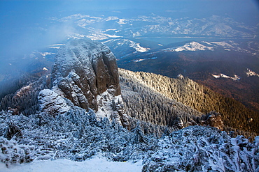 Foggy winter landscape in Ceahlaul Massif, Romania, Europe