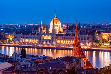 The Hungarian Parliament Building and River Danube at night, UNESCO World Heritage Site, Budapest, Hungary, Europe