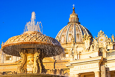 St. Peter's Basilica Cupola and fountain in early morning light, Vatican City, UNESCO World Heritage Site, Rome, Lazio, Italy, Europe
