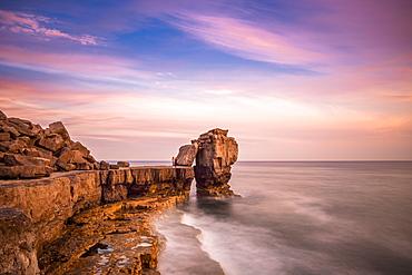 Sunset at Pulpit Rock, limestone sea stack on heavily quarried coast of Portland Bill on England's Jurassic Coast, UNESCO World Heritage Site, Dorset, England, United Kingdom, Europe