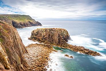 Enys Dodnan rock formation at Lands End, Cornwall, England, United Kingdom, Europe