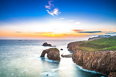Dramatic sky at sunset with Enys Dodnan and the Armed Knight rock formations at Lands End, Cornwall, England, United Kingdom, Europe
