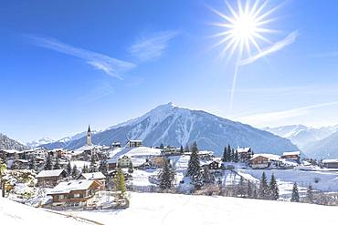 The sun shines on Davos Wiesen, Albula Valley, District of Prattigau/Davos, Canton of Graubunden, Switzerland, Europe