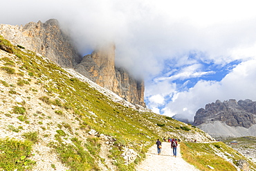 Tourists walks on the pathway for Three Peaks of Lavaredo, Dolomites of Sesto, Province of Belluno, Veneto, Italy, Europe