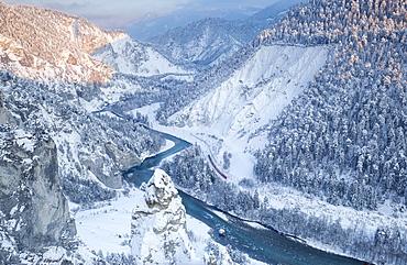 Transit of the Red Train in the deep Rhine Gorge, Rhein Gorge (Ruinaulta), Flims, Imboden, Graubunden, Switzerland, Europe