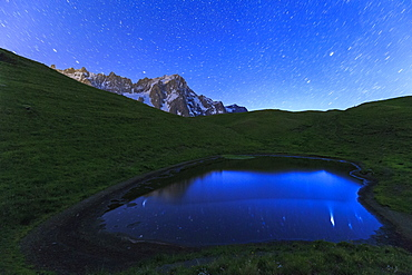 Stars reflected in a pool, Mont de la Saxe, Ferret Valley, Courmayeur, Aosta Valley, Italy, Europe