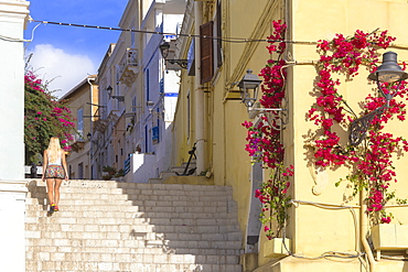 A tourist walks up steps at Carloforte, San Pietro Island, Sud Sardegna province, Sardinia, Italy, Mediterranean, Europe
