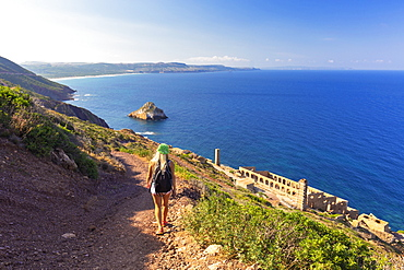 A girl walks on a path to Laveria Lamarmora, Nebida, Iglesias, Sud Sardegna province, Sardinia, Italy, Mediterranean, Europe