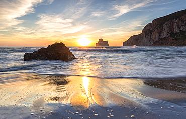 The sunset reflected on the Beach of Masua, Iglesias, Sud Sardegna province, Sardinia, Italy, Mediterranean, Europe