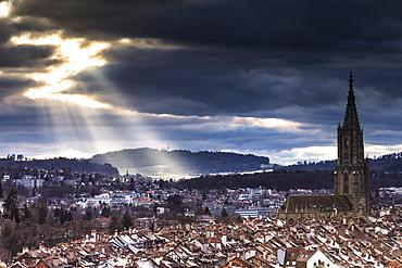 Sun ray between clouds above Bern Minster (Cathedral) (Berner Munster), Bern, Canton of Bern, Switzerland, Europe