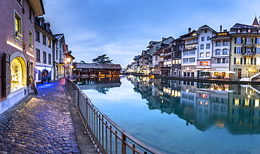Traditional houses reflected in the Aare River, Thun, Canton of Bern, Switzerland, Europe