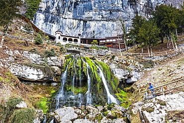 Tourist looking at St. Beatus Waterfall, Beatenberg, Canton of Bern, Switzerland, Europe