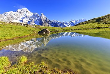 Mont Blanc group reflected in the Lac des Vesses (Vesses Lake), Veny Valley, Courmayeur, Aosta Valley, Italy, Europe