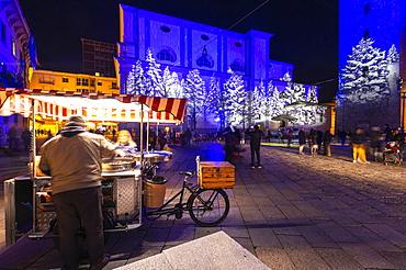 Chestnut seller in the square at night, Sondrio, Valtellina, Sondrio province, Lombardy, Italy, Europe