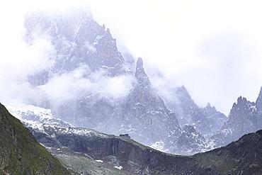 Summer blizzard on Monzino Hut and Aiguille Noire de Peuterey, Monzino Hut, Veny Valley, Courmayeur, Aosta Valley, Italy, Europe