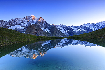 Mont Blanc reflected in Lac Checrouit (Checrouit Lake) at sunrise, Veny Valley, Courmayeur, Aosta Valley, Italy, Europe