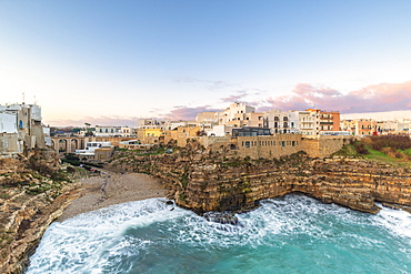 Sunrise with view on the beach of Lama Monachile from above, Polignano a Mare, Apulia, Italy, Europe