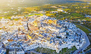Aerial view by drone of the old town of Ostuni at sunset, Apulia, Italy, Europe