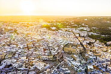 Aerial view by drone of Polignano a Mare at sunrise, Polignano a Mare, Apulia, Italy, Europe