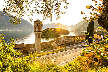 Traditional bell tower of Ossuccio with view of the Comacina Island and Lake Como, Lombardy, Italian Lakes, Italy, Europe