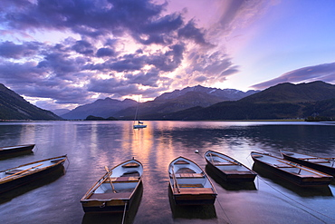 Moored boats in Lake of Sils at sunrise, Maloja Pass, Engadine valley, Graubunden, Switzerland, Europe