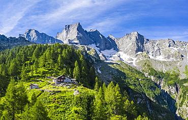 Sasc Fura hut with the famous Pizzo Badile in the background, Bondasca valley, Bregaglia valley, Graubunden, Switzerland, Europe
