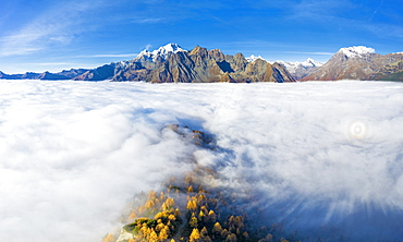 Fog covers the Valmalenco (Val Malenco) with the Disgrazia in the background and Brioken spectre, Valtellina, Lombardy, Italy, Europe