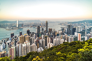 View over Victoria Harbour at sunset, seen from Victoria Peak, Hong Kong Island, Hong Kong, China, Asia