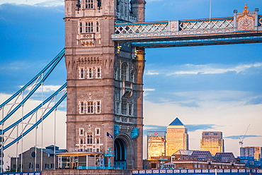 Tower bridge framing Canary Wharf at sunset, London, England, United Kingdom, Europe