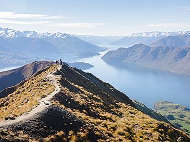 Hikers enjoying the view from the Roys Peak hiking trail near Wanaka, Otago, South Island, New Zealand, Pacific