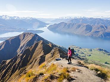Woman hiker enjoying the view from the Roys Peak trail near Wanaka, Otago, South Island, New Zealand, Pacific