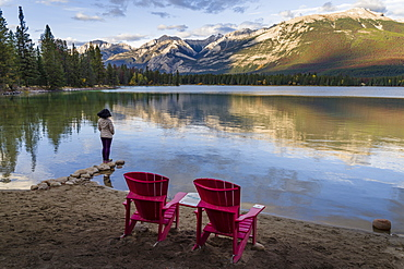Tourist and Red Chairs by Lake Edith, Jasper National Park, UNESCO World Heritage Site, Canadian Rockies, Alberta, Canada, North America