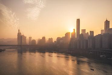 Chongqing city skyline at dawn, with the view of the Yuzhong peninsula CBD and Jialing River, Chongqing, China, Asia