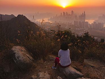 Tourist enjoys watching sunset of Chongqing skyline from the Nanshan mountain, Chongqing, China, Asia