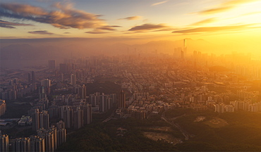 Kowloon and Hong Kong city view at sunset from the Lion Rock mountain peak, Hong Kong, China, Asia