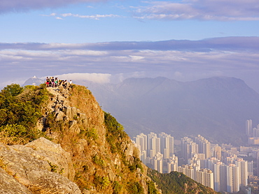 Hikers at the Lion Rock mountain peak, viewing the city of Hong Kong from a high point, Hong Kong, China, Asia