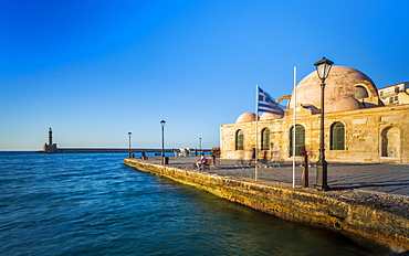 Hassan Pasha Mosque and The Venetian era harbour and the lighthouse at the port of Chania, Crete, Greek Islands, Greece, Europe