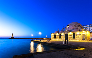 Lighthouse at Venetian port and Turkish Mosque Hassan Pasha at night, Chania, Crete, Greek Islands, Greece, Europe