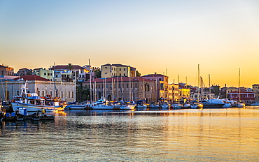 Dusk light over moored boats in the harbour, Chania, Crete, Greek Islands, Greece, Europe
