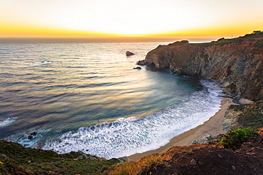 Sunset over The Pacific Ocean at Andrew Molera State Park south of Monterey, Big Sur, California, United States of America, North America