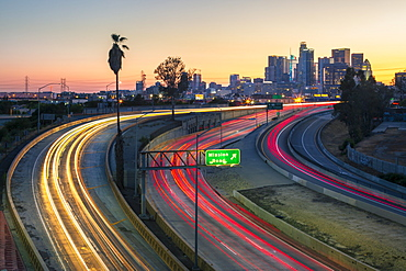 View of Downtown skyline and Mission Road at night, Los Angeles, California, United States of America, North America