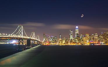 View of San Francisco skyline and Oakland Bay Bridge from Treasure Island at night, San Francisco, California, United States of America, North America