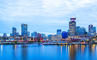 City skyline including Vancouver Lookout Tower as viewed from Canada Place at dusk, Vancouver, British Columbia, Canada, North America