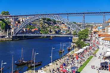 View of Dom Luis I Bridge over Douro River and Vila Nova de Gaia waterfront with Porto wine ships and Ribeira view, Porto, Portugal, Europe