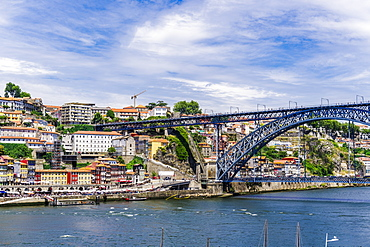 View of Dom Luis I bridge over Douro River and Ribeira view with traditional buildings and Funicular of Guindais, Porto, Portugal, Europe
